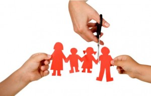 Divorce effect on kids concept with hands cutting paper people family - isolated; Shutterstock ID 58110952